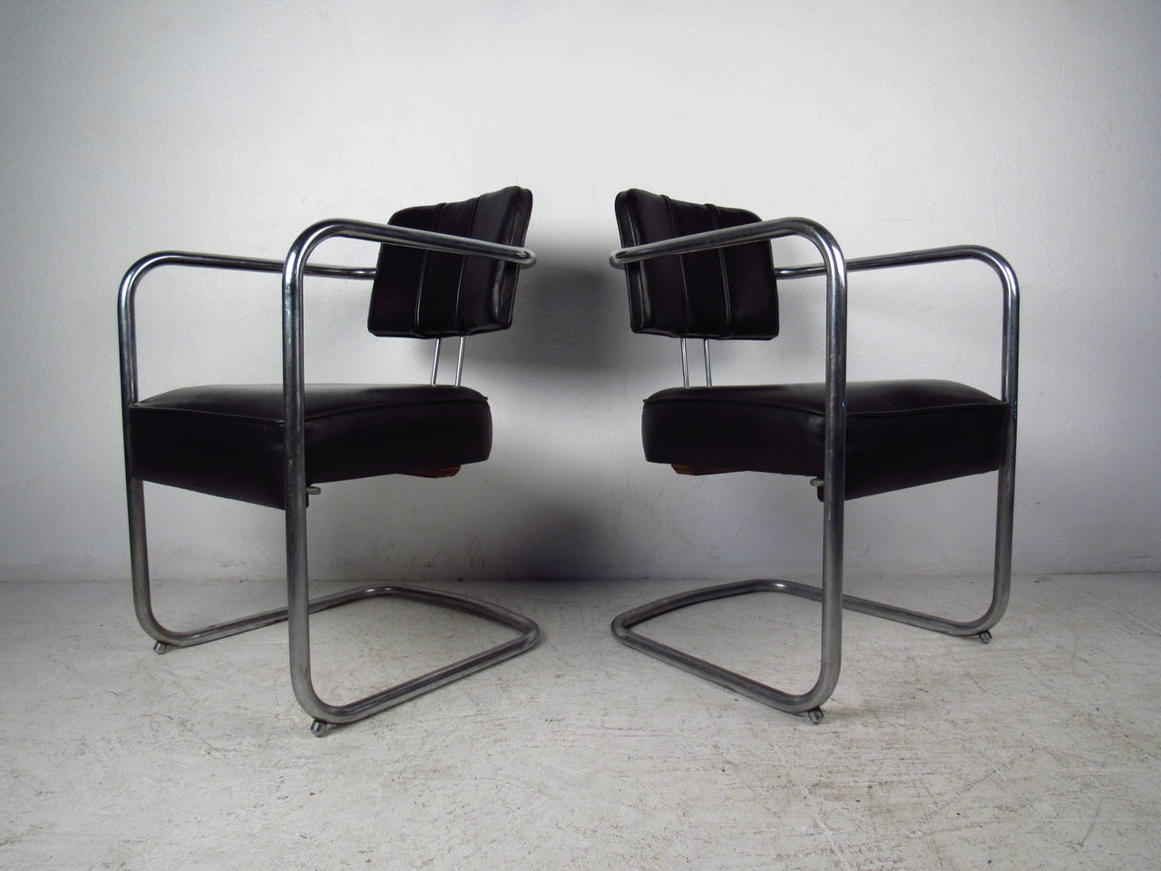 Mid-Century Modern Set of Four Italian Black Leather and Chrome Chairs For Sale