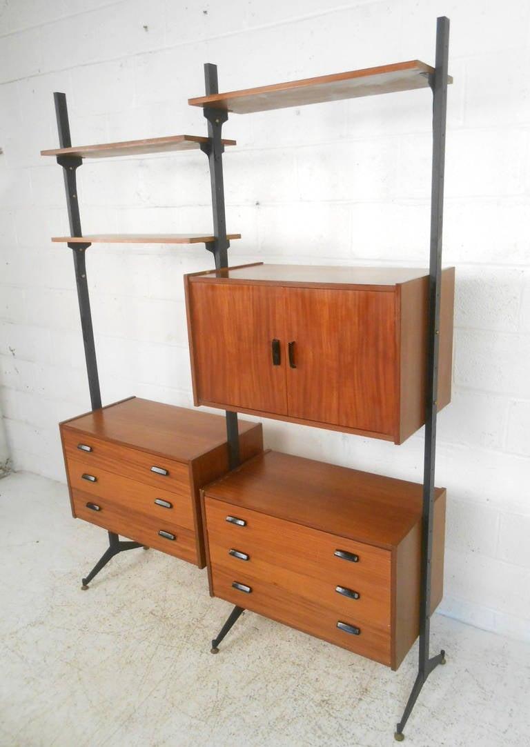 This Beautiful Teak Wall Unit Features An Adjustable Combination Of Drawers  And Cabinets For Storage,