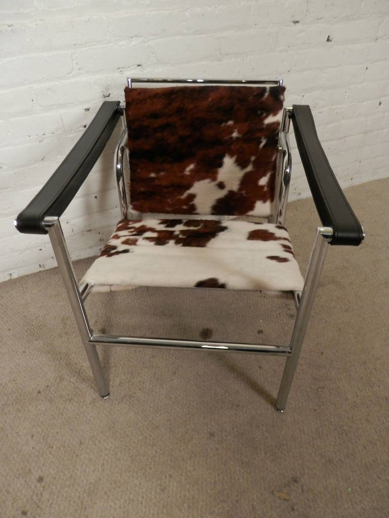 Italian Mid Century Modern Le Corbusier Cow Hide Chair With Chrome Frame.  Features
