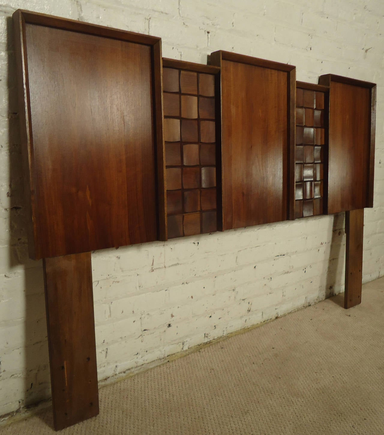 Vintage-modern headboard, features three large panels with beautiful walnut grain and two narrow sculpted panels.