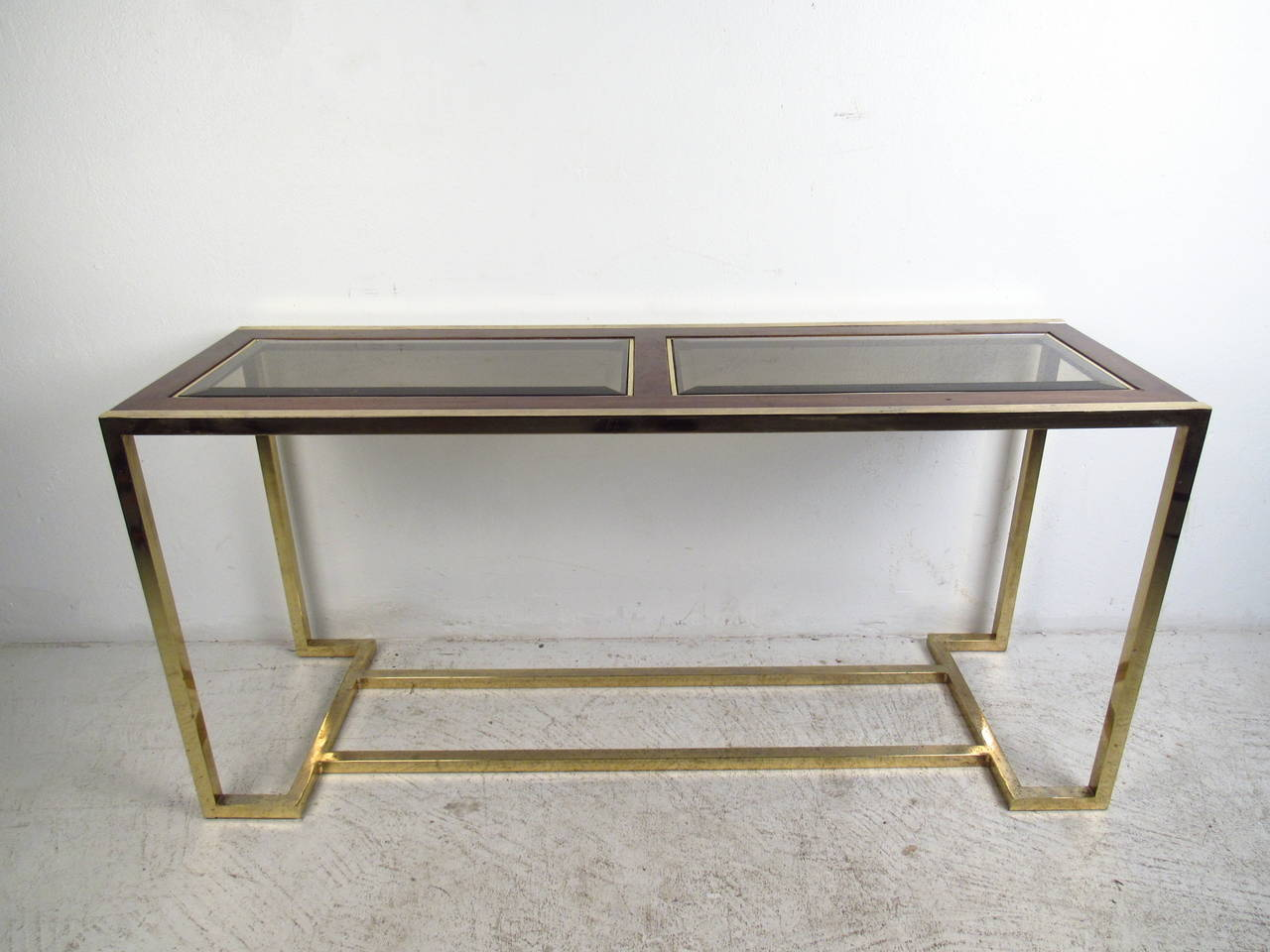 Mid century modern brass and walnut console table with smoked glass