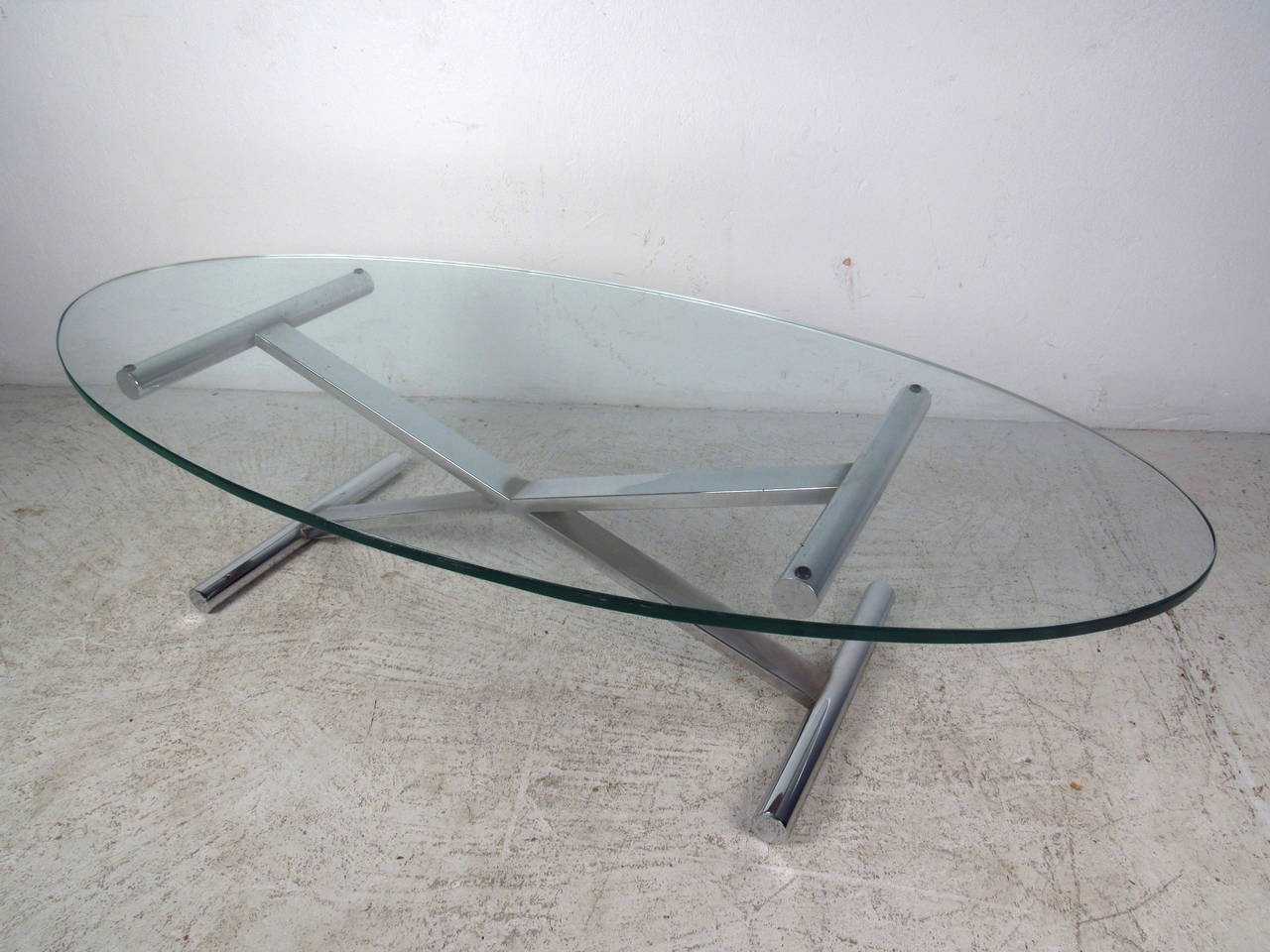 Oval Shaped Glass Top Coffee Table With Chrome Base For