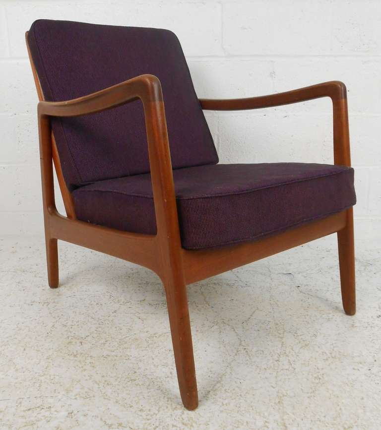 Stylish Ole Wanscher Lounge Chair Features Sturdy Teak Construction,  Vintage Upholstery, And Stylish Mid