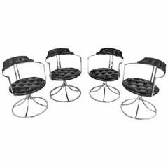 Set of Mid-Century Chrome And Vinyl Swivel Dining Chairs