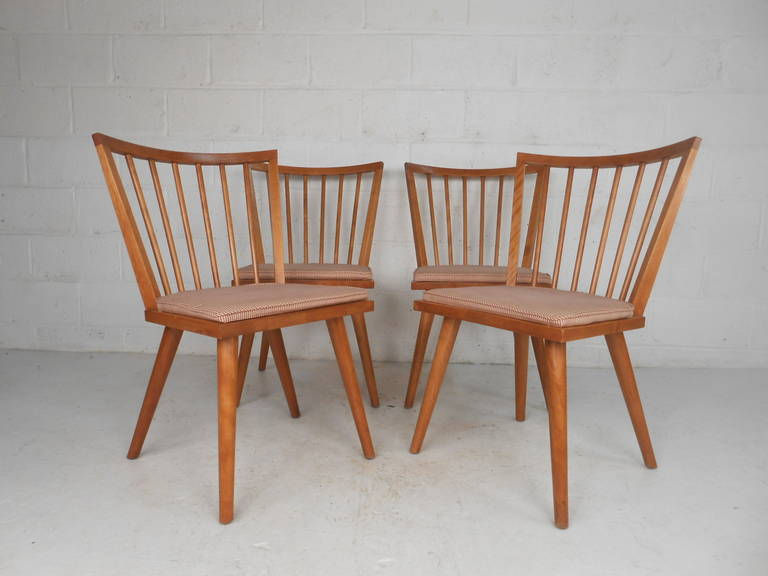 Set of four Mid-Century Modern Windsor style maple dining chairs by Leslie Diamond for Conant-Ball with stamp. Stylish and sturdy spoke back maple chairs with upholstered seats make the perfect addition to kitchen or dining room seating.   (Please