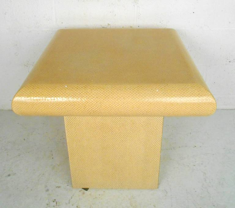 Vintage Springer inspired side table wrapped in an attractive faux snake skin. Deep curves around the edges with a square base.  (Please confirm item location - NY or NJ - with dealer).