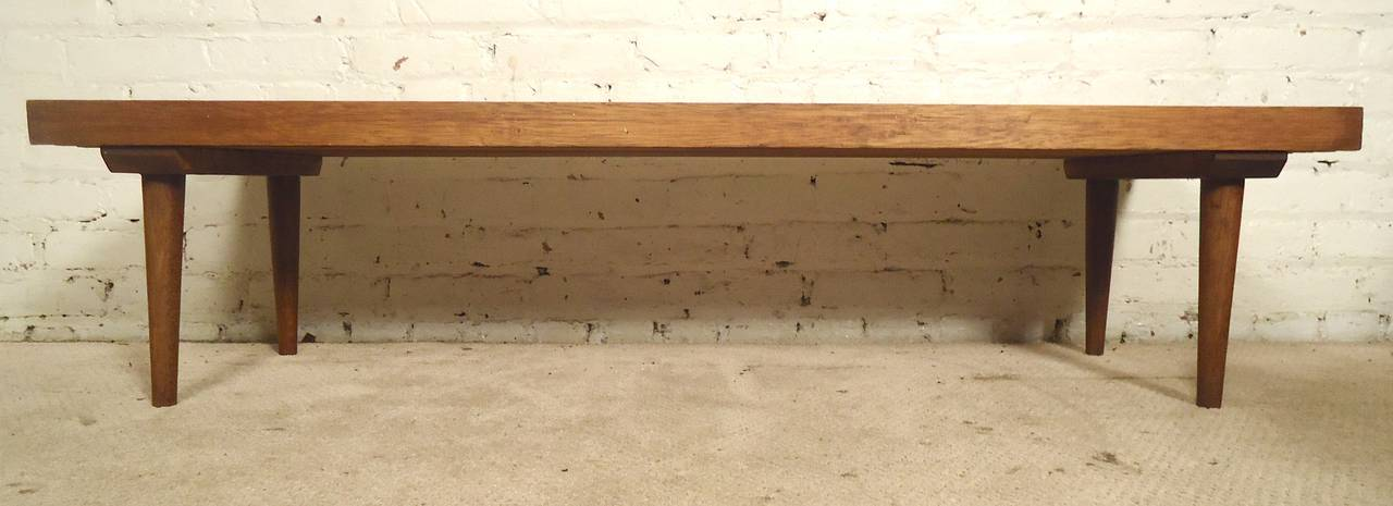 Classic slat bench or table in walnut with tapered legs. Great as a living room table or window bench.  (Please confirm item location - NY or NJ - with dealer).