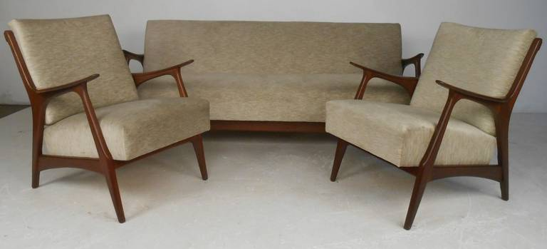 Stylish three-piece Danish modern living room suite with sofa or daybed and two armchairs. Nicely crafted teak frames and sofa easily converts into daybed for added convenience. Please confirm item location (NY or NJ) with dealer.
