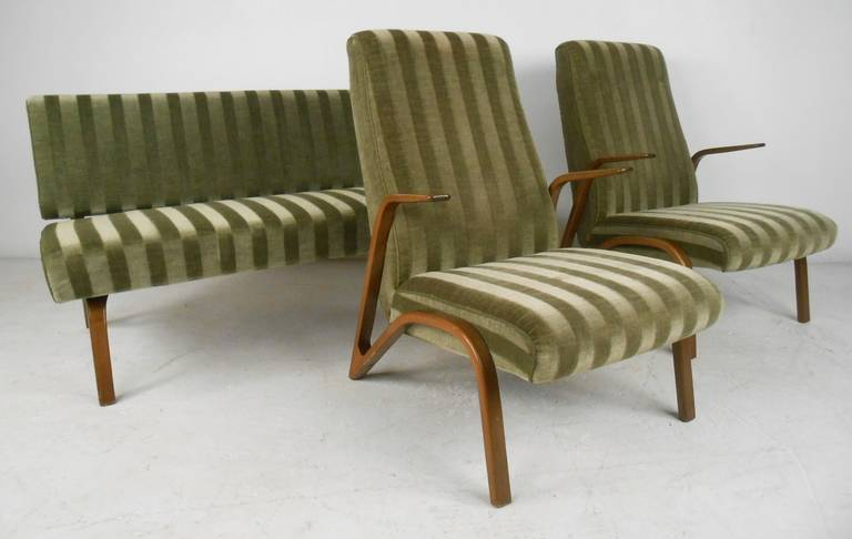 Rare, complete set designed by Paul Bode for Deutsche Federholzgesellschaft, Kassel in 1955. Consisting of sofa, two chairs and table, the fabric is a striped green velour with the table top a walnut veneer. Please confirm item location (NY or NJ)
