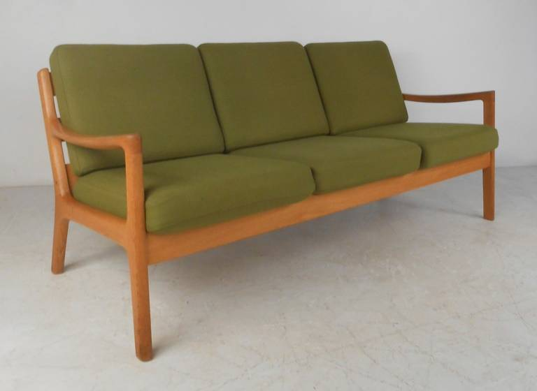 Scandinavian modern sofa designed by Ole Wanscher in 1951 and manufactured by Cado (France & Son). Striking and comfortable seating addition to home or business setting. Please confirm item location (NY or NJ) with dealer.