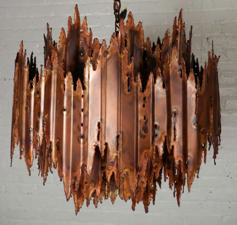 Brutalist hanging lamp constructed of distressed alloy, designed by Tom Greene. A true piece of functional art.  (Please confirm item location - NY or NJ - with dealer).