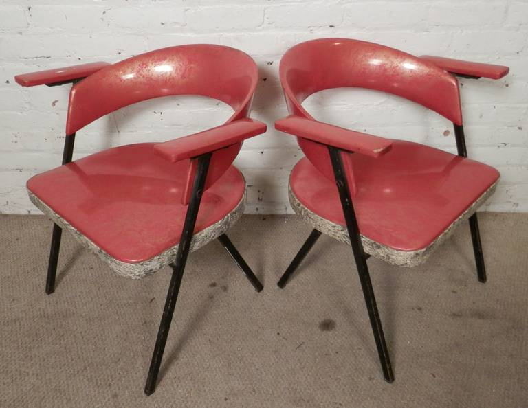 Ultra-sixties style round back chairs with original vinyl fabric. Black legs, heavy angled design.