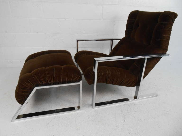 Mid-Century Modern lounge chair in the style of Milo Baughman features flat chrome frame, tufted vintage fabric, and stylish design. Comfortable and impressive club chair with matching ottoman makes a great addition to home or business. Please