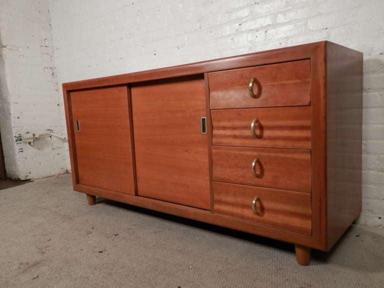 Mid-Century Modern John Stuart Labeled Sliding Door Cabinet For Sale