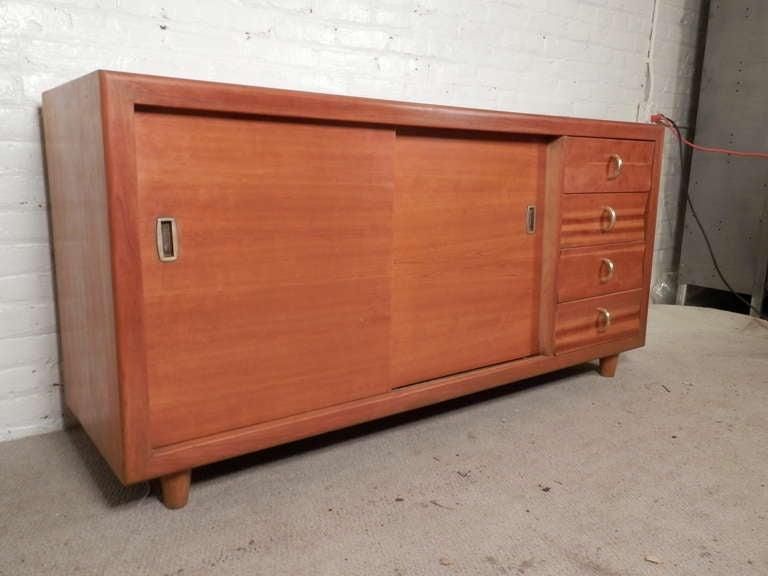 American John Stuart Labeled Sliding Door Cabinet For Sale
