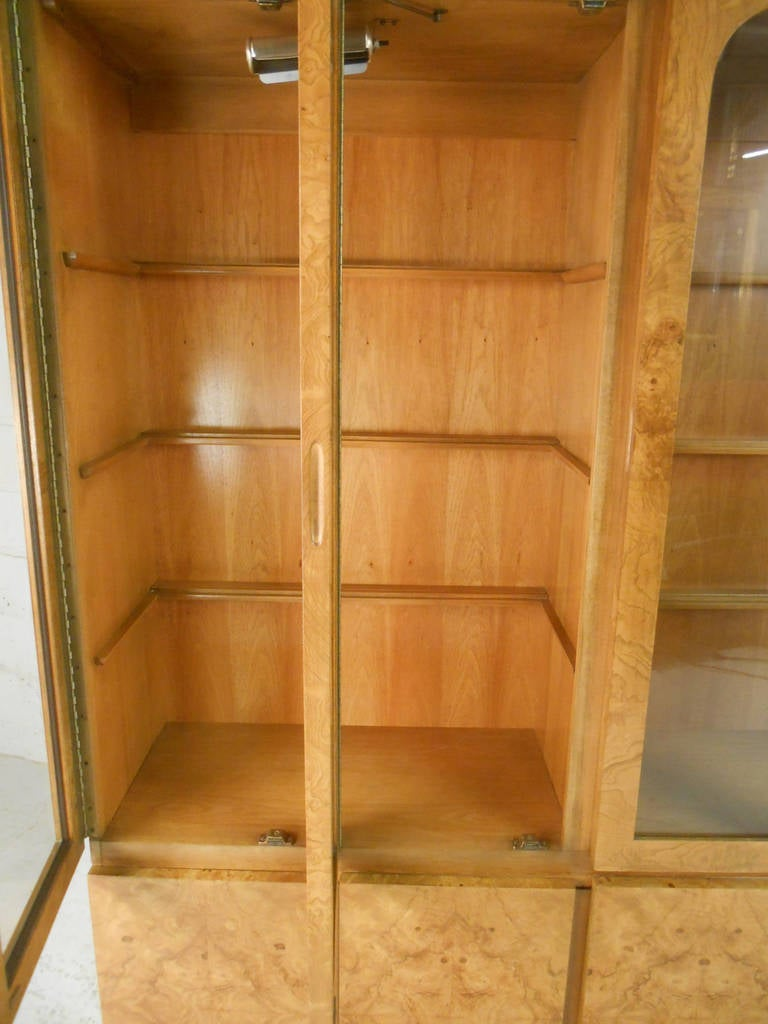 This beautiful two-piece display cabinet features plenty of well lit cabinet display space, as well as ample storage. The beautiful burl finish and quality Lane construction make this a unique addition to any room. Please confirm item location (NY
