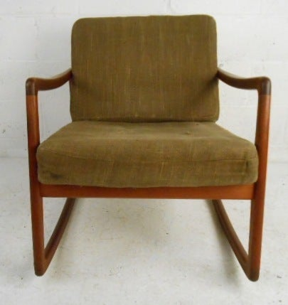 Teak, low slung rocker by France & Daverkosen, one of Denmark's greatest furniture makers. Please confirm item location (NY or NJ).