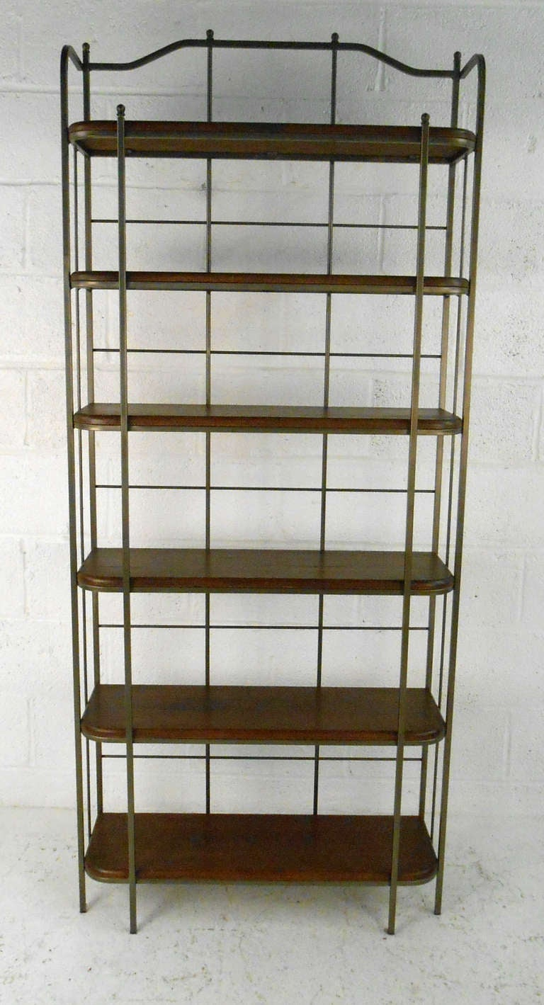 Featuring bronze finished frame and hardwood shelves this uniquely designed shelving unit is great as a book case or display case for home or business. Please confirm item location (NY or NJ).