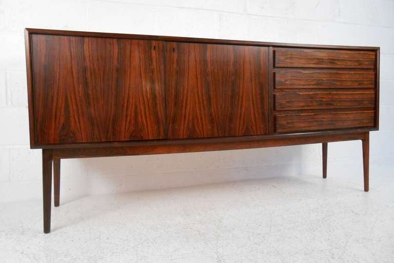 Elegant, well-crafted rosewood credenza made in Denmark by Maurice Villency. Please confirm item location (NY or NJ) with dealer.