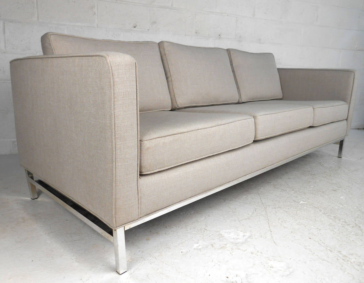 This beautiful chrome frame sofa features wonderful upholstery and fantastic midcentury design. Uniquely long sofa makes a gorgeous addition to any modern setting. Please confirm item location (NY or NJ).