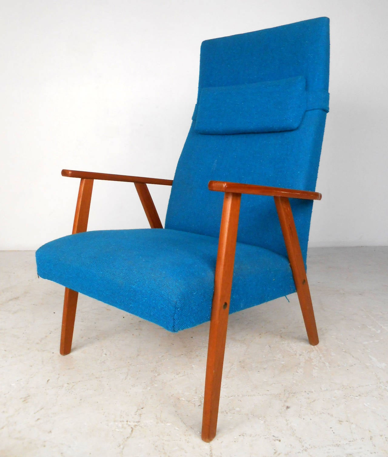 This beautiful vintage armchair features sturdy Mid-Century construction and a comfortable molded high backseat. Perfect lounge chair in wonderful vintage fabric. Removable headrest and retro style make this a great addition to any room. Please
