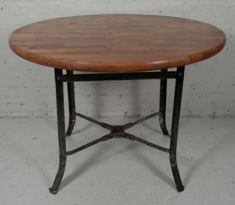 Butcher block dining table with industrial metal base at for How to make a sturdy table base