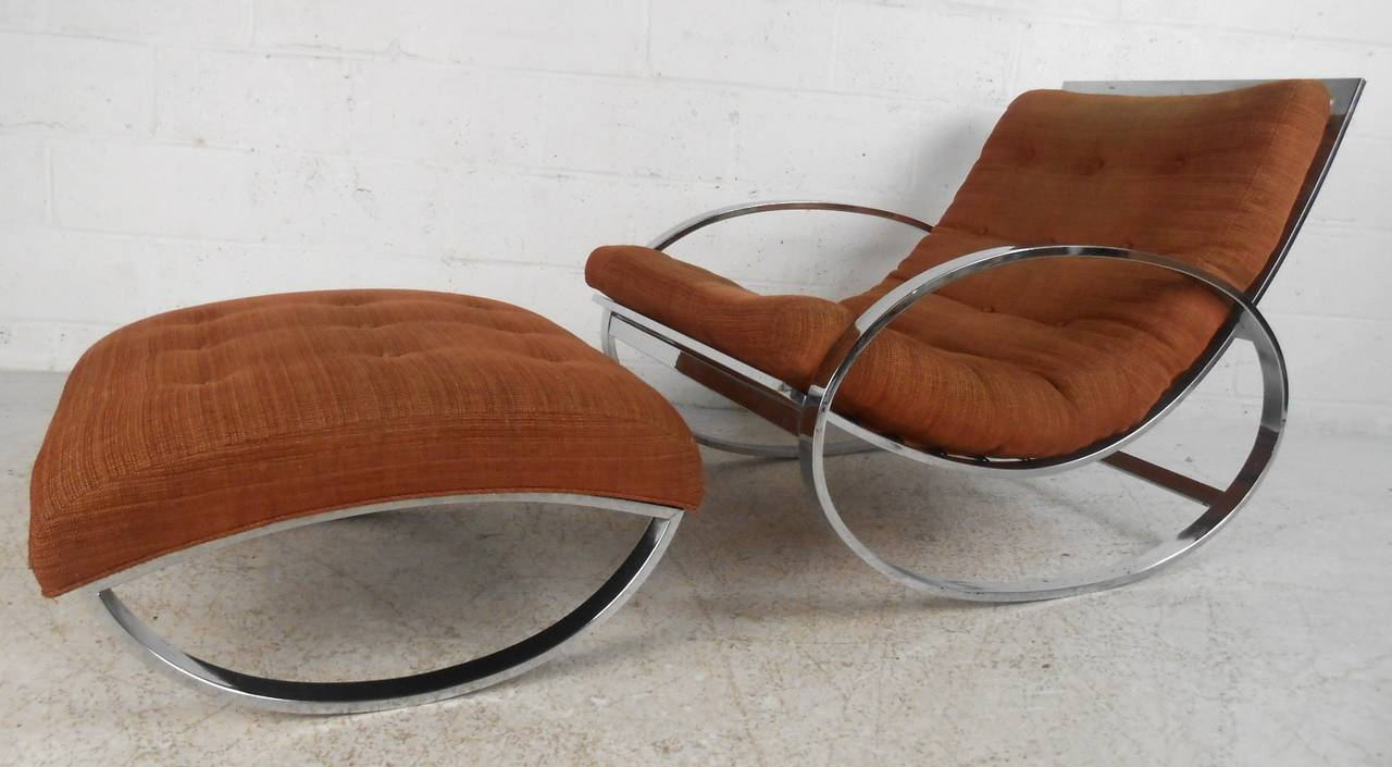This stylish Italian rocker features the Mid-Century design of Renato Zevi, comfortable tufted fabric paired with modern style chrome frame make this unique chair a wonderful addition to any room. Please confirm item location (NY or NJ).