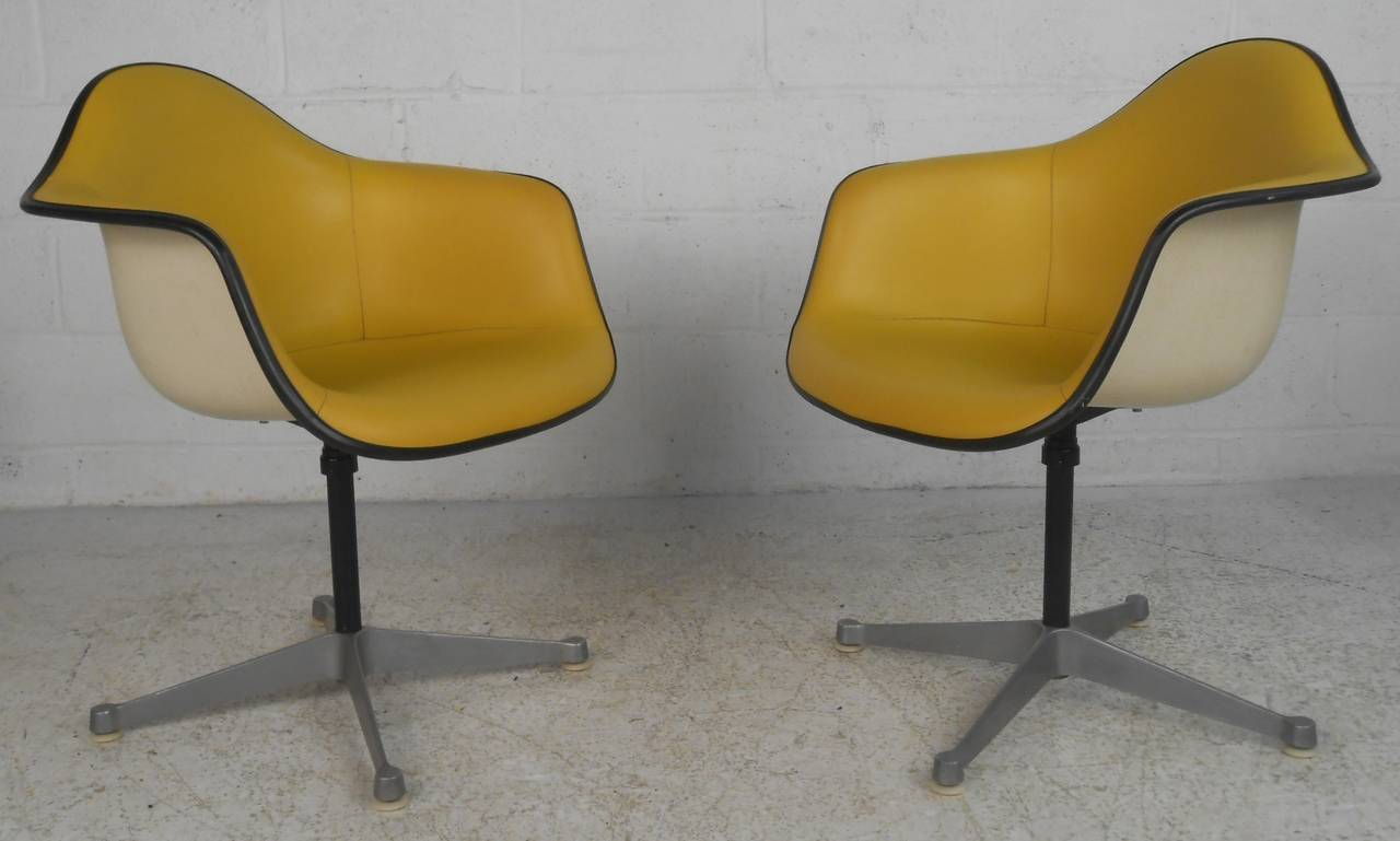 Matching Pair Of Yellow Vinyl Shell Chairs On Swivel Bases. Please Confirm  Item Location (
