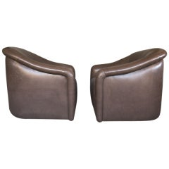 Pair of swivel lounge chairs by A. RUDIN of Los Angeles