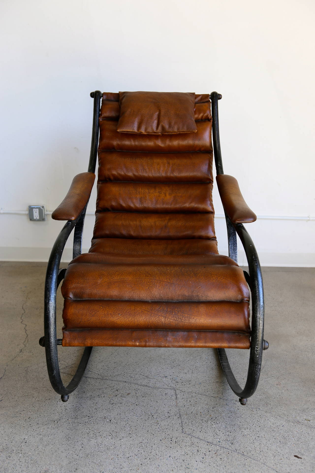 Sculptural leather and steel rocking chair at stdibs
