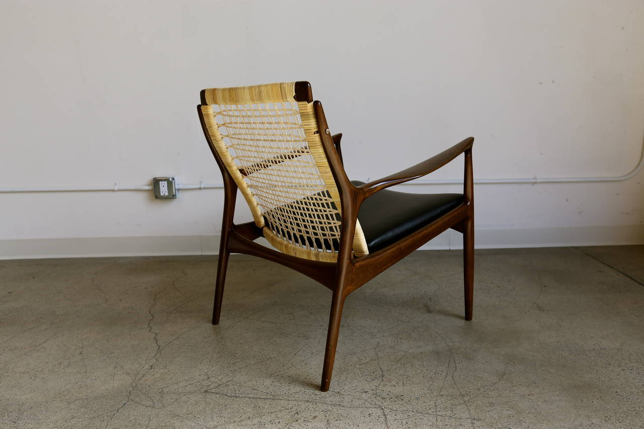 This sculptural pair of lounge chairs by ib kofod larsen is no longer - Caned Lounge Chair By Ib Kofod Larsen For Selig Of Denmark 3