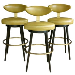Set of three leather swivel barstools by Maurice Baily Of Monteverde Young
