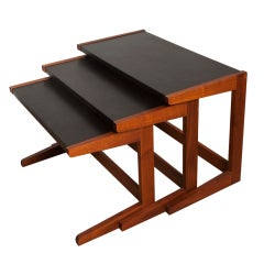Walnut and leather nesting tables