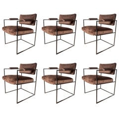 Set of six dining arm chairs by MILO BAUGHMAN for THAYER COGGIN