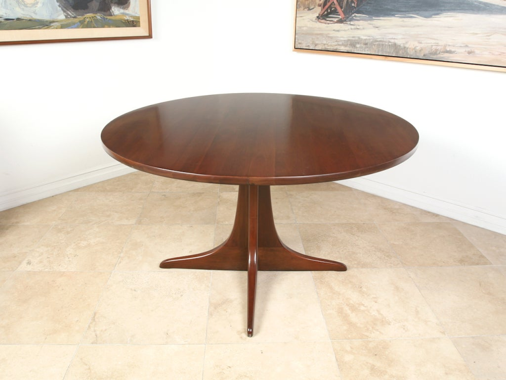 this mid century solid wood dining table and swivel chairs is no