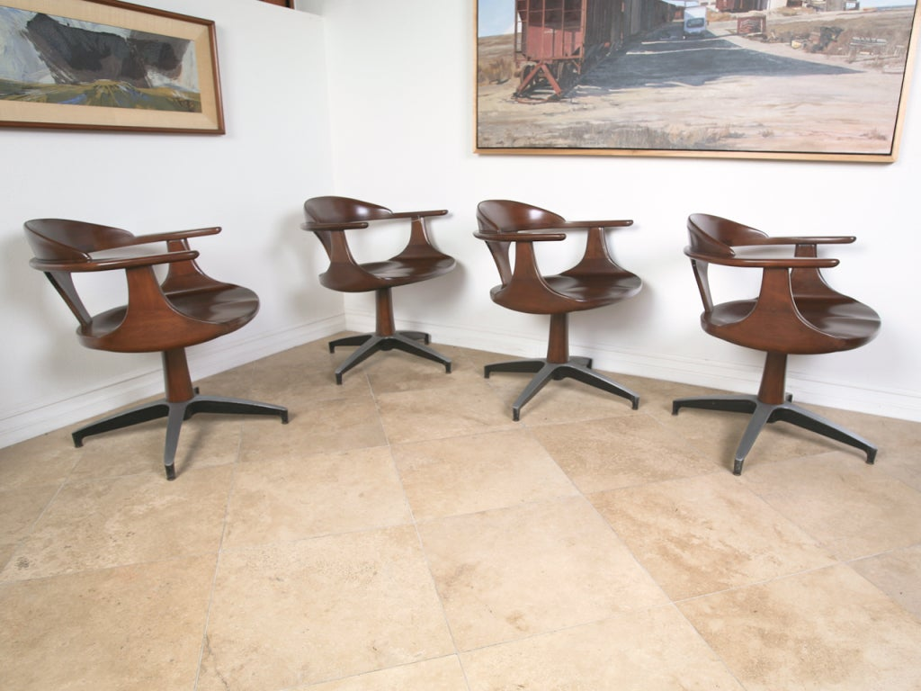 mid century solid wood dining table and swivel chairs at 1stdibs
