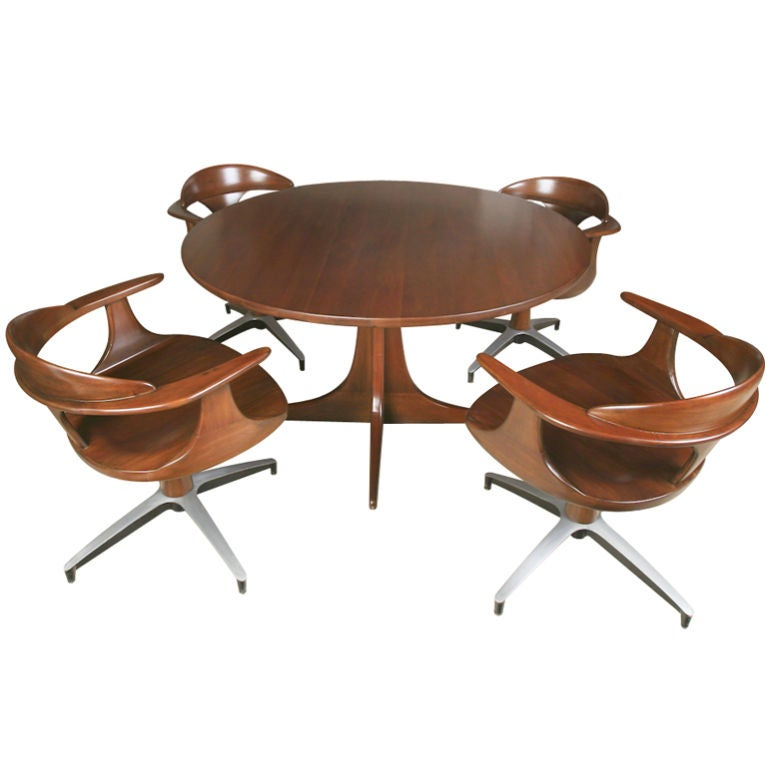 mid century solid wood dining table and swivel chairs at