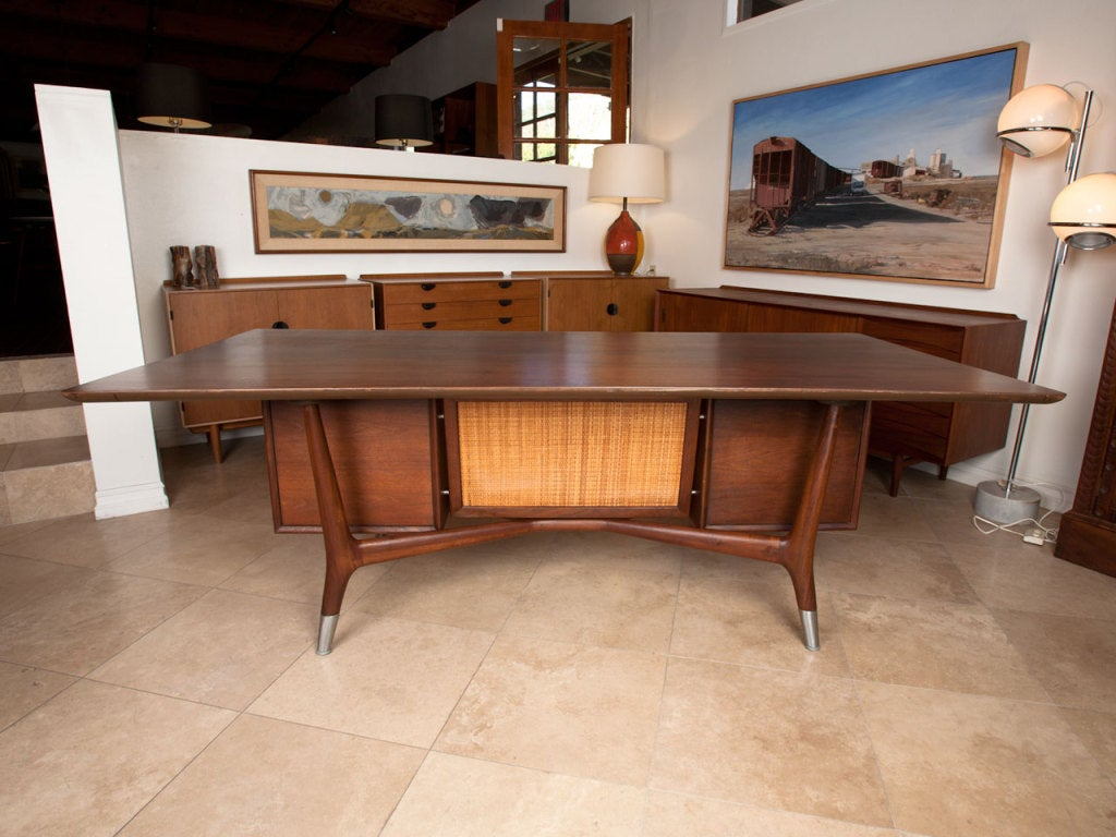 Mid century walnut American executive desk.  This piece looks to be heavily influenced by Italian design of the period.