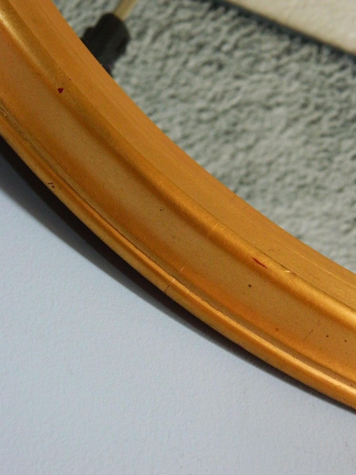 Elegant oval gilt mirror by LaBarge.