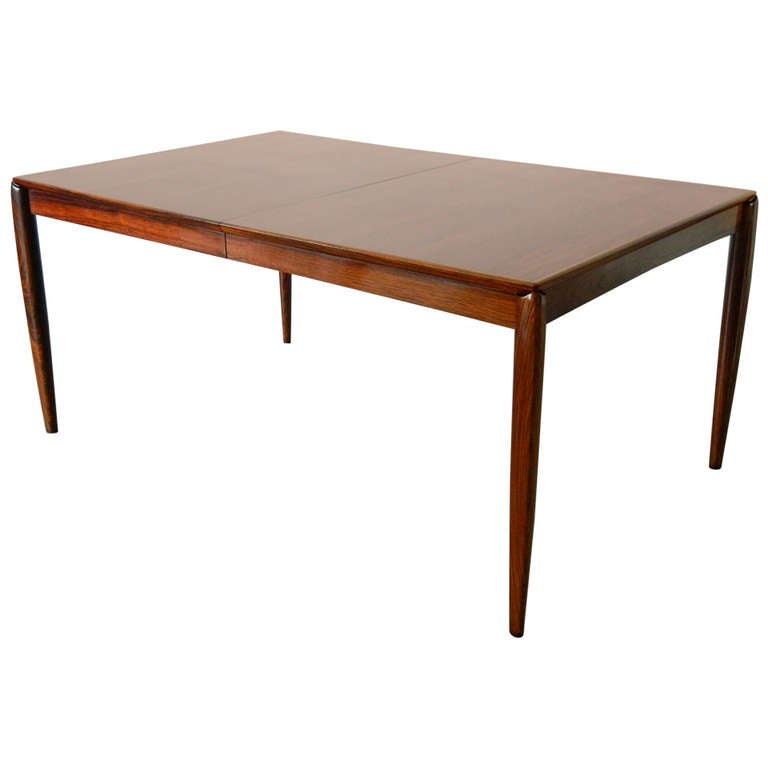 Mid century modern rosewood dining table at 1stdibs for Mid century modern dining table