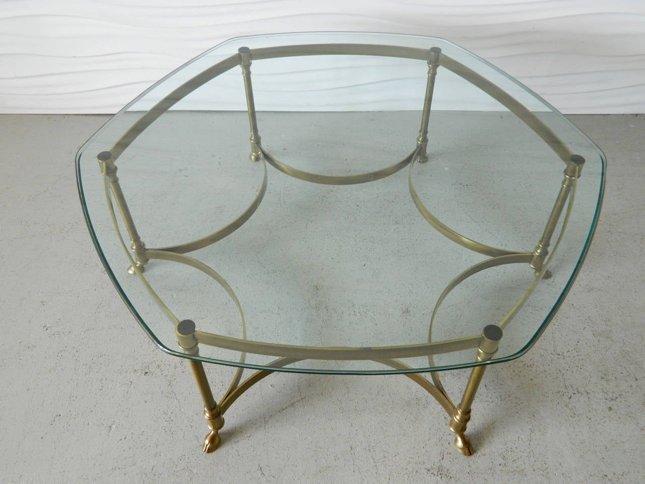 hollywood regency hexagonal brass coffee table in the style of