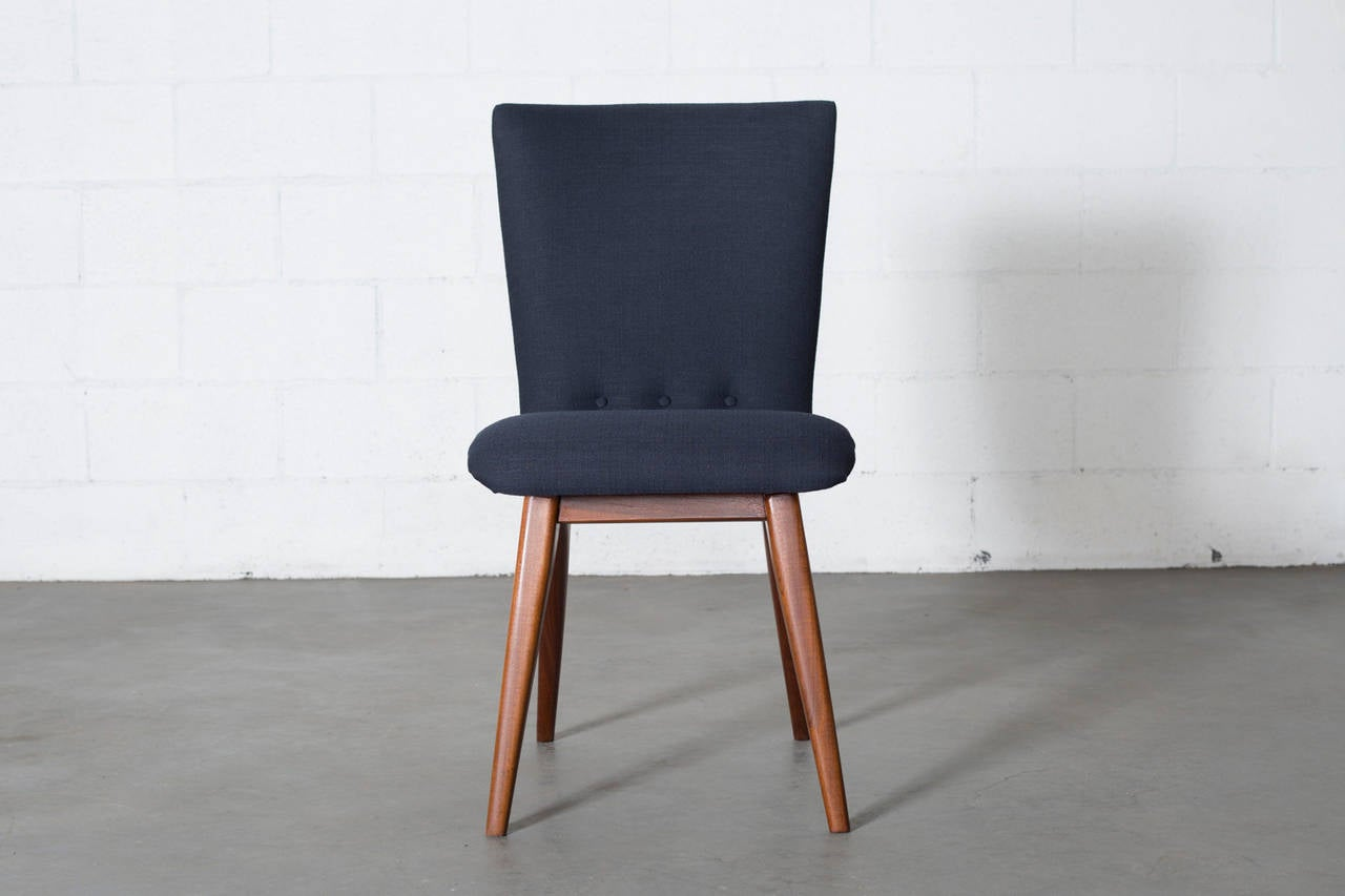 set of four os curved teak dining chairs in navy at