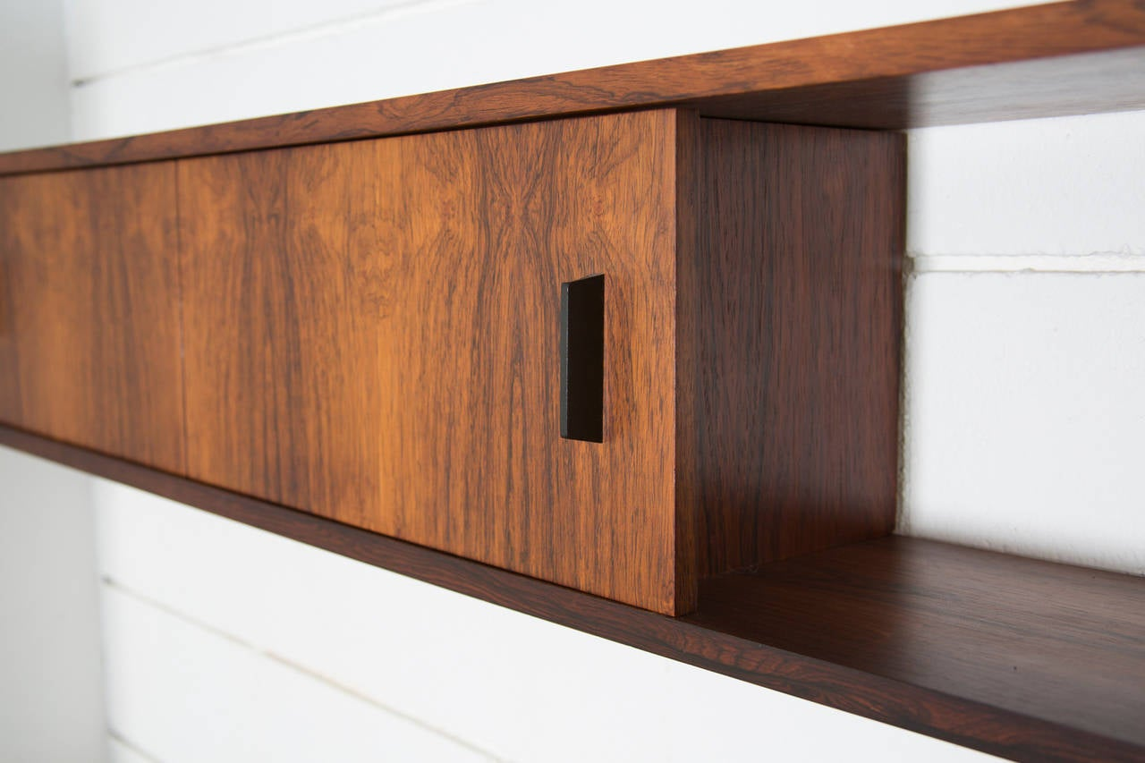 Floating rosewood wall system at stdibs