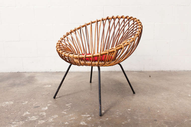 Genial Rattan Hoop Chair With Petal Like Interlocking Detail And Enameled Black  Tubular Frame And A