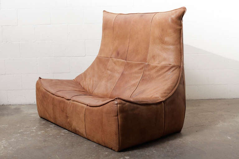 Super comfortable two seater leather sofa designed by Gerard van den Berg for Montis 1970 in natural leather.