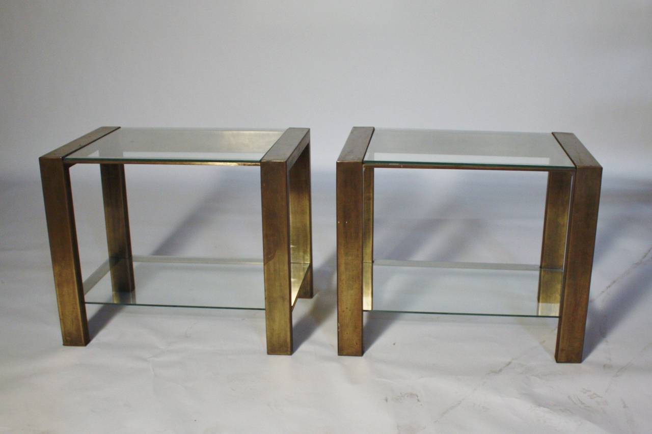 Custom manufactured two-tiered heavy bronzed metal and glass end or night tables. New custom cut-glass.