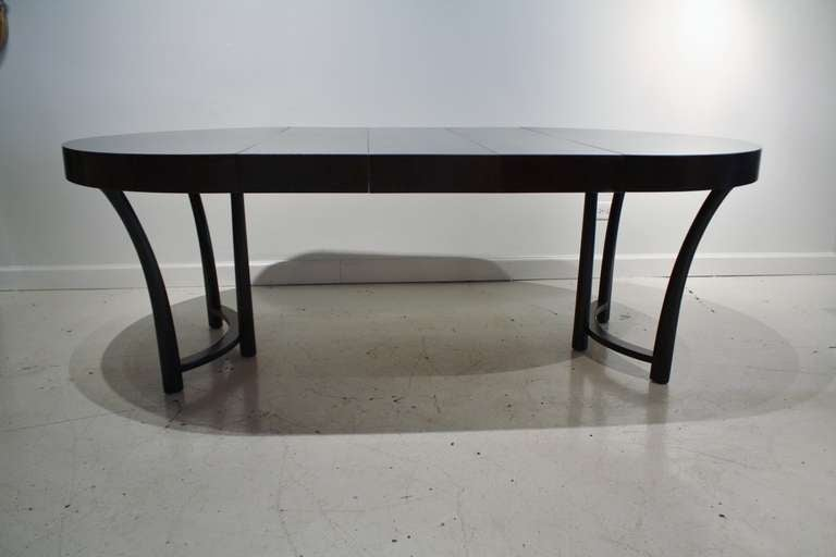 T h robsjohn gibbings expandable round dining table at for Dining at at t center