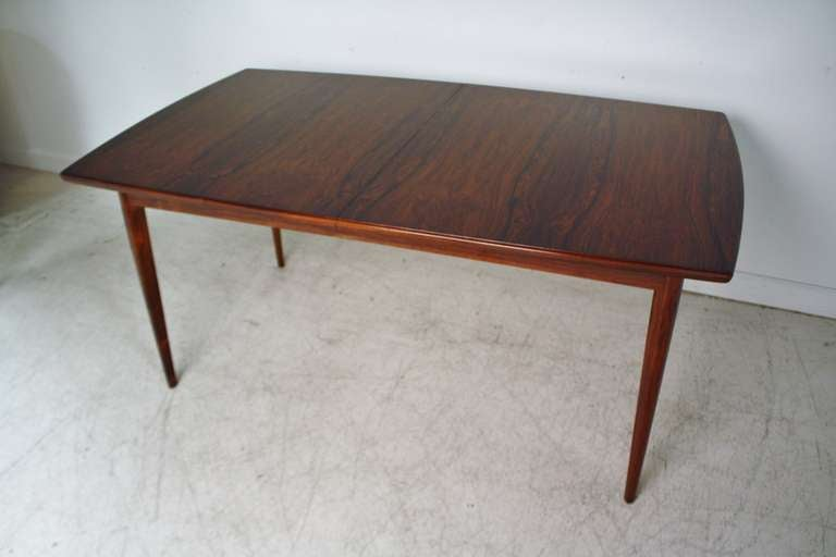 1960s rosewood dining table from norway expands to conceal two