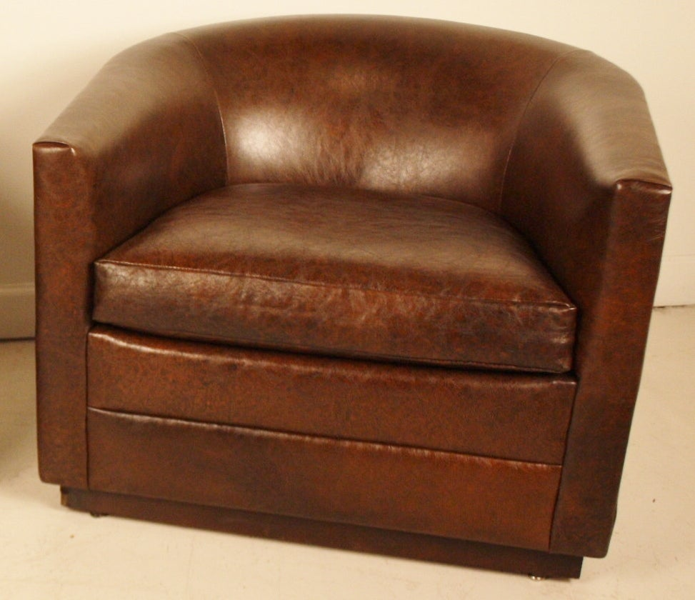 Pair of leather barrel club chairs at 1stdibs
