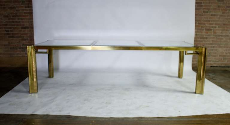 "Mid-Century expandable brass and beveled glass dining table by Mastercraft. Leaf extend table and additional 30"" from 77""L x 45 3/4""w x 29"" totalling 107"" long."
